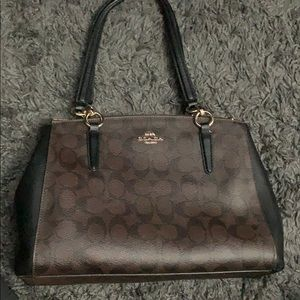 Black and brown Coach purse